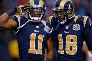Brandon Gibson #11 of the St. Louis Rams salutes with his teammate  Austin Pettis #18